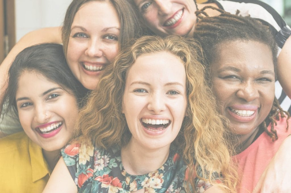 group of ladies smiling at church