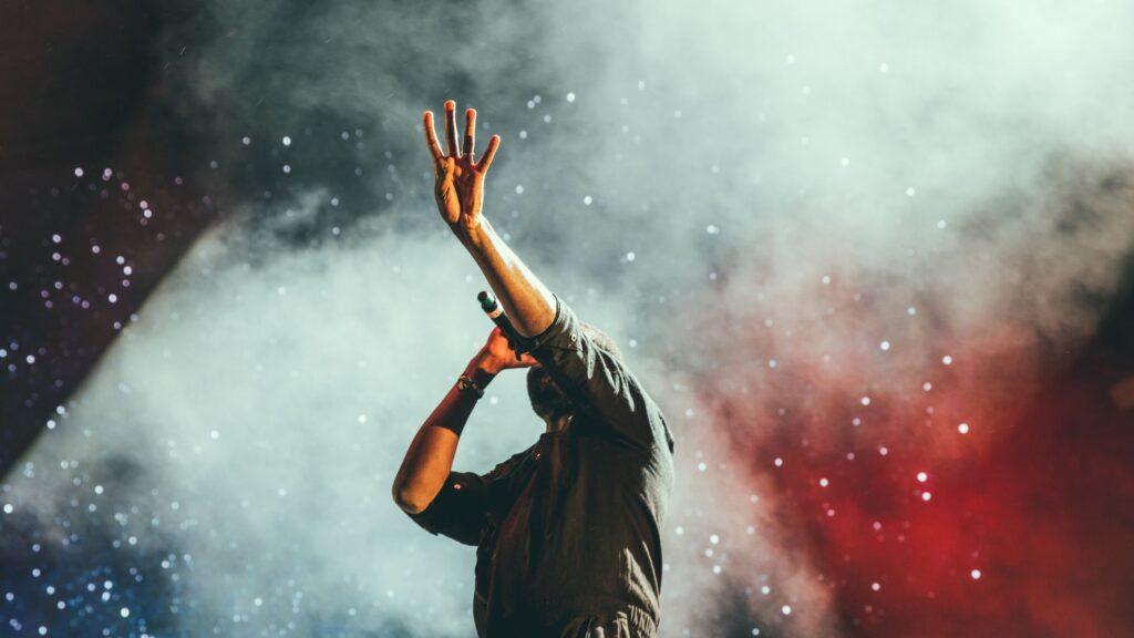 man singing praise and worship on stage