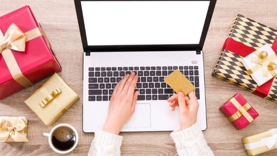 woman using credit card on laptop to shop