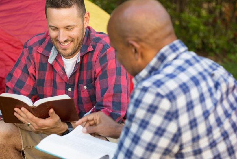 2 men talking about christian gifts for men and reading their bible
