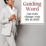 confident woman in a light grey business suit with a sign that says to choose a guiding word of the year