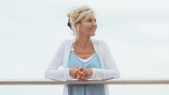 older woman looking out over the ocean