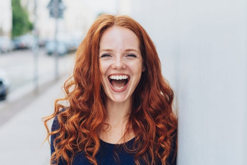 happy red-headed woman