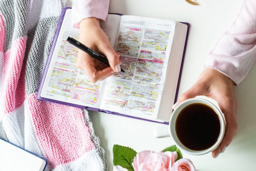 Woman-verse-mapping-a-Bible-verse-and-drinking-coffee