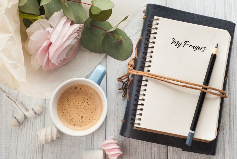 Prayer-Journal-and-a-cup-of-coffee-on-a-table