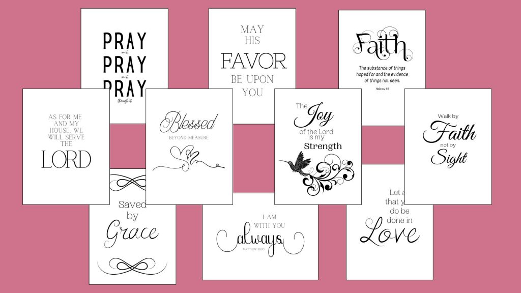 black and white scripture art laying on a pink backdrop