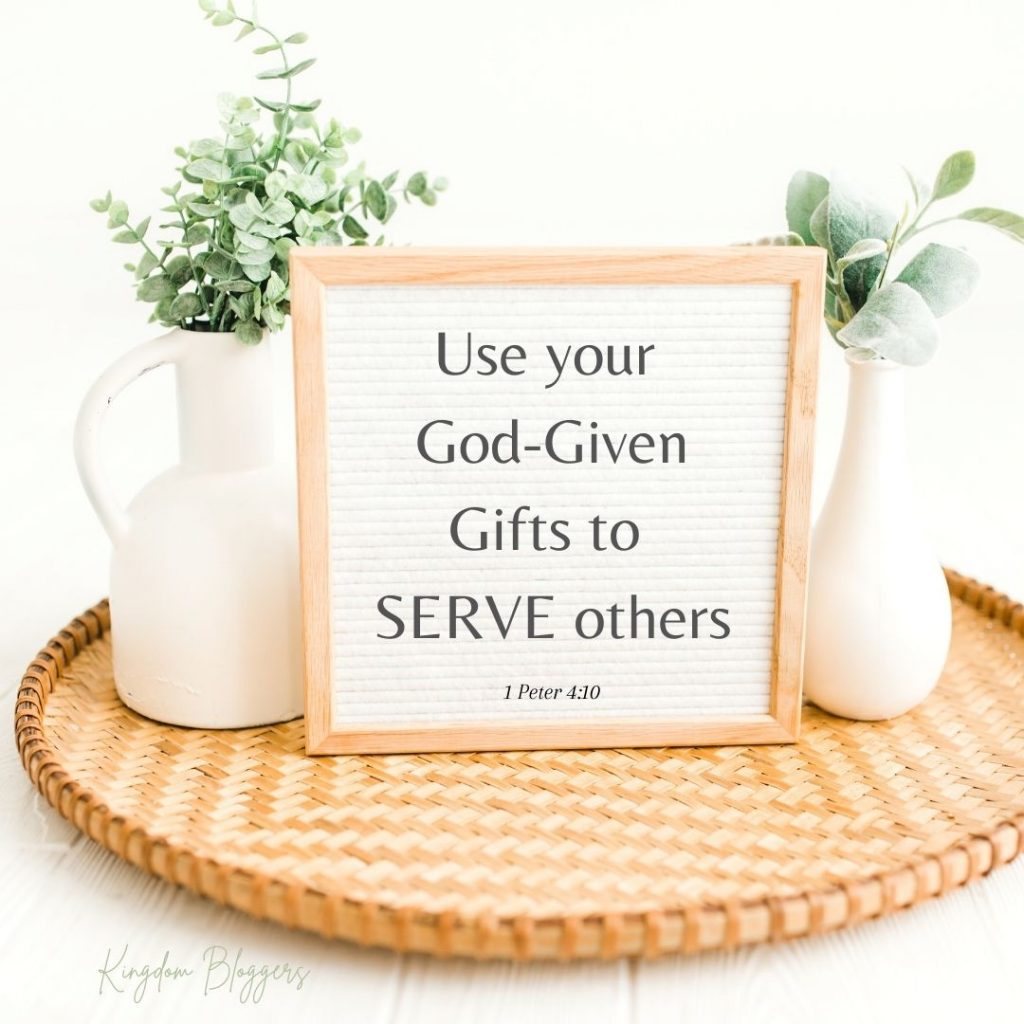 wicker serving tray with 2 white vases and a whiteboard that says to use your talents to serve others