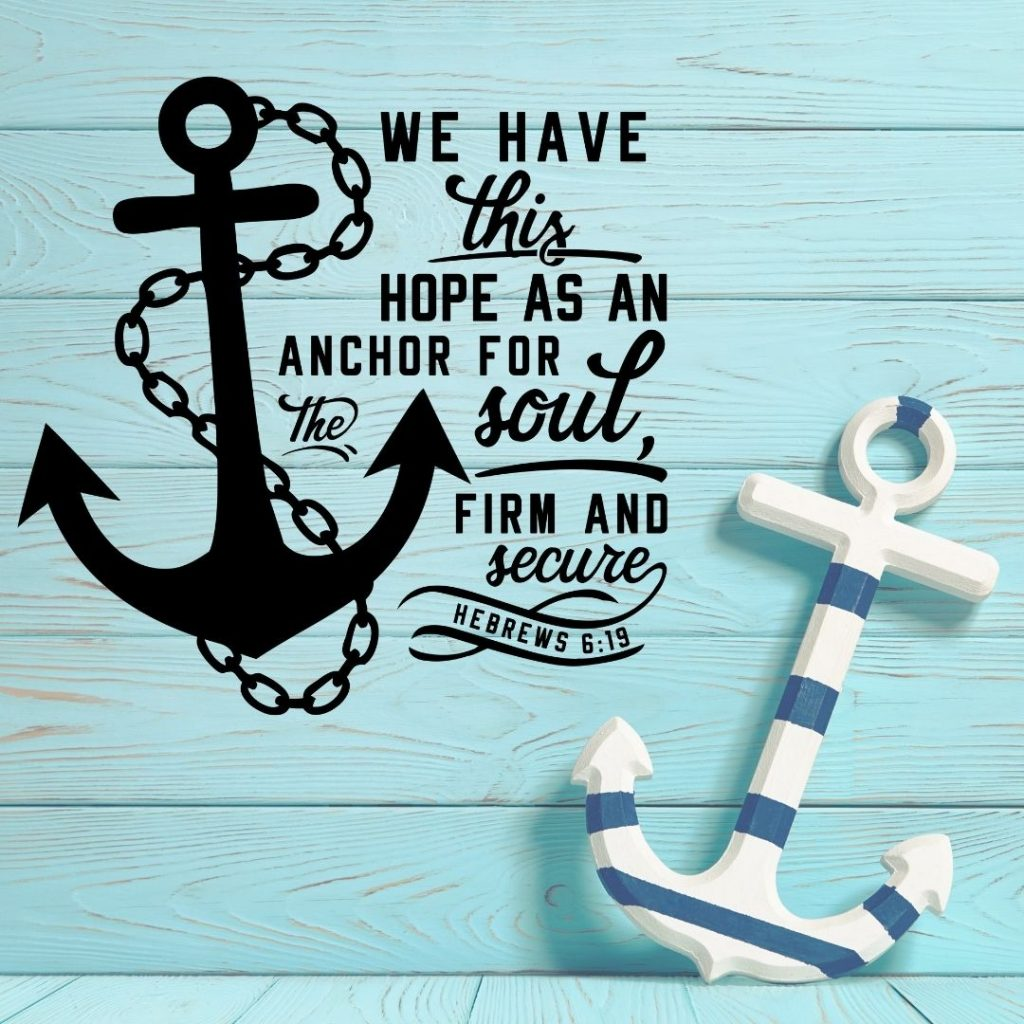 turquoise wooden background with an anchor