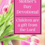 pink tulips in the background with sign that says mother's day devotional