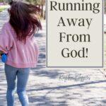 woman running away down a sidewalk