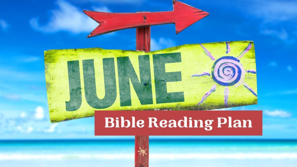 June Bible Reading Plan on a colorful sign on the beach