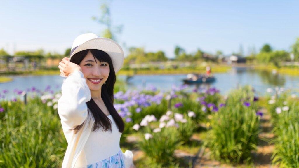 asian woman walking in a flower garden