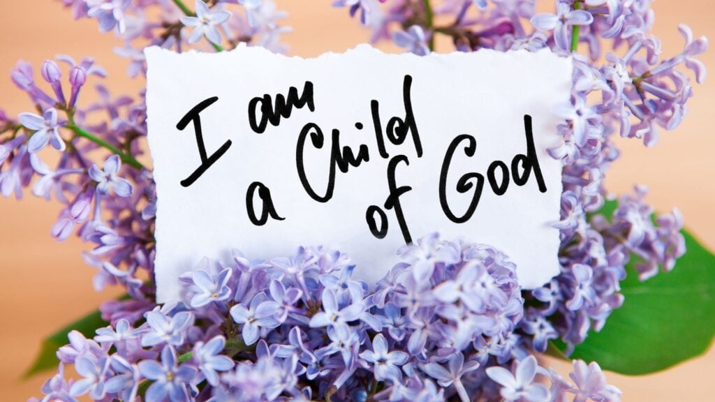 I Am a Child of God on a piece of paper