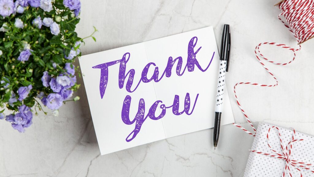 a thank you note on a table